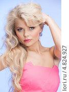 Купить «Молодая стройная женщина с распущенными волосами в розовом платье на голубом фоне», фото № 4824927, снято 1 мая 2010 г. (c) Syda Productions / Фотобанк Лори