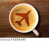 Купить «Белая чашка с силуэтом самолёта на поверхности кофе», фото № 4834647, снято 30 июня 2013 г. (c) Сергей Петерман / Фотобанк Лори