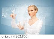 Купить «Счастливая девушка нажимает на кнопки на виртуальном экране», фото № 4862803, снято 30 октября 2010 г. (c) Syda Productions / Фотобанк Лори
