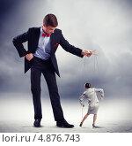 Купить «Кукольник управляет бизнес-леди-марионеткой», фото № 4876743, снято 12 января 2013 г. (c) Sergey Nivens / Фотобанк Лори