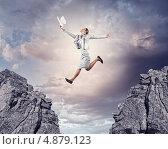 Купить «Решительный рывок вперед. Деловая женщина с разбегу прыгает через пропасть», фото № 4879123, снято 7 июля 2012 г. (c) Sergey Nivens / Фотобанк Лори