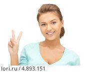 Купить «Счастливая молодая женщина в голубом джемпере», фото № 4893151, снято 28 августа 2011 г. (c) Syda Productions / Фотобанк Лори