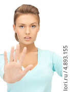 Купить «Девушка говорит стоп, протянув ладонь», фото № 4893155, снято 28 августа 2011 г. (c) Syda Productions / Фотобанк Лори