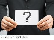 Купить «Мужские руки держат карточку со знаком вопроса», фото № 4893383, снято 18 февраля 2013 г. (c) Syda Productions / Фотобанк Лори