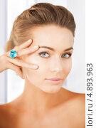Купить «Красивая молодая женщина с перстнем», фото № 4893963, снято 17 марта 2013 г. (c) Syda Productions / Фотобанк Лори