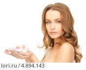 Купить «Красивая женщина с лепестками роз на белом фоне», фото № 4894143, снято 10 октября 2010 г. (c) Syda Productions / Фотобанк Лори