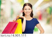 Купить «Счастливая молодая покупательница в торговом центре», фото № 4901111, снято 21 января 2020 г. (c) Syda Productions / Фотобанк Лори