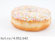 Купить «Аппетитный пончик с посыпкой», фото № 4952643, снято 6 февраля 2012 г. (c) Wavebreak Media / Фотобанк Лори