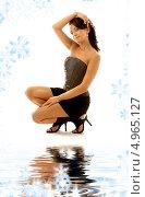Купить «Девушка в корсете и короткой юбке сидит у воды на фоне со снежинками», фото № 4965127, снято 20 августа 2006 г. (c) Syda Productions / Фотобанк Лори