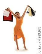Купить «Счастливая юная покупательница с пакетами на белом фоне», фото № 4989975, снято 19 августа 2006 г. (c) Syda Productions / Фотобанк Лори
