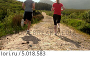 Купить «Fit couple jogging together in the countryside away from camera», видеоролик № 5018583, снято 11 июля 2020 г. (c) Wavebreak Media / Фотобанк Лори