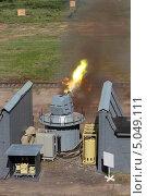 Купить «Стрельба из скорострельной двенадцатиствольной корабельной пушки на военном полигоне», фото № 5049111, снято 3 июля 2013 г. (c) Игорь Долгов / Фотобанк Лори