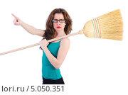 Купить «Строгая девушка в очках держит на плече метлу и указывает пальцем на что-то», фото № 5050351, снято 23 апреля 2013 г. (c) Elnur / Фотобанк Лори