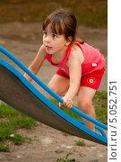Купить «Девочка взбирается на горку», фото № 5052751, снято 26 августа 2013 г. (c) WalDeMarus / Фотобанк Лори