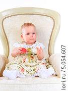 Купить «Годовалая девочка в светлом платье на кресле с игрушкой», фото № 5054607, снято 26 октября 2012 г. (c) Андрей Армягов / Фотобанк Лори