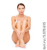 Купить «Красивая стройная брюнетка в скромном белом белье сидит на полу, согнув ноги в коленях», фото № 5070615, снято 25 июля 2013 г. (c) Syda Productions / Фотобанк Лори