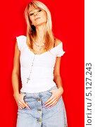 Купить «Девушка в джинсовой юбке со светлыми волосами на красном фоне», фото № 5127243, снято 7 октября 2006 г. (c) Syda Productions / Фотобанк Лори