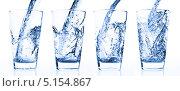 Купить «Вода наливается в стакан», фото № 5154867, снято 9 октября 2009 г. (c) Станислав Фридкин / Фотобанк Лори