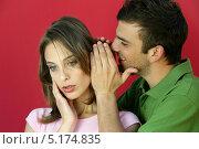 Купить «Парень что-то шепчет девушке на ухо», фото № 5174835, снято 23 апреля 2007 г. (c) Phovoir Images / Фотобанк Лори