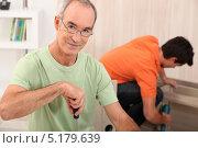 Купить «Отец с сыном собирают мебель», фото № 5179639, снято 7 октября 2010 г. (c) Phovoir Images / Фотобанк Лори