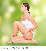 Купить «Красивая молодая женщина с гладкой кожей без целлюлита», фото № 5185219, снято 25 июля 2013 г. (c) Syda Productions / Фотобанк Лори
