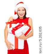 Купить «Счастливая молодая девушка держит в руках новогодние подарки», фото № 5202035, снято 15 августа 2013 г. (c) Syda Productions / Фотобанк Лори