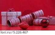 Купить «Christmas decorations spinning beside crackers and presents», видеоролик № 5226467, снято 31 мая 2020 г. (c) Wavebreak Media / Фотобанк Лори