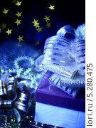 Купить «Новогодние подарки на фоне со звездами», фото № 5280475, снято 10 октября 2008 г. (c) Иван Михайлов / Фотобанк Лори
