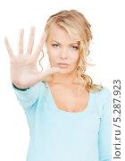 Купить «Девушка показывает жест стоп», фото № 5287923, снято 26 сентября 2009 г. (c) Syda Productions / Фотобанк Лори