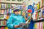 Купить «Мальчик в книжном магазине», фото № 5343363, снято 7 ноября 2013 г. (c) Володина Ольга / Фотобанк Лори