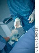 Купить «Doctor taking a scissors from the hand of a nurse», фото № 5360851, снято 24 апреля 2012 г. (c) Wavebreak Media / Фотобанк Лори