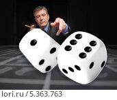 Купить «Gambler at the poker table with digital dice in foreground», фото № 5363763, снято 20 июля 2012 г. (c) Wavebreak Media / Фотобанк Лори