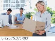 Купить «Sad businesswoman leaving office after being let go», фото № 5375083, снято 19 марта 2013 г. (c) Wavebreak Media / Фотобанк Лори