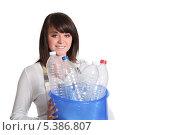 Купить «Девушка с пустыми пластиковыми бутылками», фото № 5386807, снято 4 мая 2010 г. (c) Phovoir Images / Фотобанк Лори