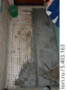 Заливка бетоном водяного теплого пола. Стоковое фото, фотограф Виталий Галямов / Фотобанк Лори