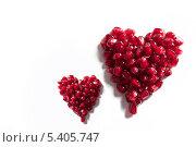Два гранатовых сердца. Стоковое фото, фотограф Игорь Перфильев / Фотобанк Лори