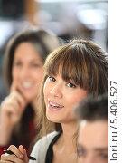 Купить «Улыбающаяся девушка среди коллег», фото № 5406527, снято 12 февраля 2010 г. (c) Phovoir Images / Фотобанк Лори