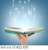 Купить «мужская рука держит открытую книгу с виртуальными буквами», фото № 5422655, снято 14 ноября 2013 г. (c) Syda Productions / Фотобанк Лори