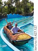 Купить «Восторженные туристы на аттракционе водные горки», фото № 5427127, снято 3 июля 2013 г. (c) Евгений Ткачёв / Фотобанк Лори