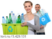 Купить «Пара с пустыми пластиковыми бутылками», фото № 5429131, снято 6 декабря 2010 г. (c) Phovoir Images / Фотобанк Лори