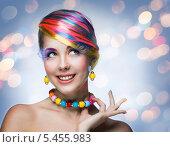 Купить «Красивая женщина с цветными прядями, с ярким макияжем, в разноцветном ожерелье, на абстрактном фоне с бликами», фото № 5455983, снято 9 декабря 2013 г. (c) Типляшина Евгения / Фотобанк Лори