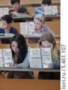 Купить «Concentrated students working on their digital tablets», фото № 5461107, снято 25 июля 2012 г. (c) Wavebreak Media / Фотобанк Лори