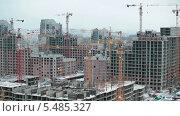 Купить «Большая строительная площадка зимой», видеоролик № 5485327, снято 15 января 2014 г. (c) Кекяляйнен Андрей / Фотобанк Лори