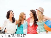 Купить «четыре подруги с мячом и полотенцем гуляют по пляжу», фото № 5498287, снято 4 июля 2013 г. (c) Syda Productions / Фотобанк Лори