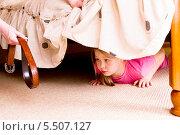 Купить «Девочка прячется от ремня под кроватью», фото № 5507127, снято 21 мая 2011 г. (c) Юлия Гапеенко / Фотобанк Лори