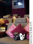 Купить «Две маски на мягком диване с подушками в кинотеатре», фото № 5542171, снято 4 сентября 2012 г. (c) Losevsky Pavel / Фотобанк Лори