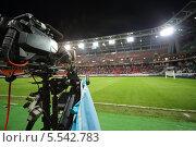 Купить «Видеокамера на фоне футбольного стадиона», фото № 5542783, снято 7 сентября 2012 г. (c) Losevsky Pavel / Фотобанк Лори