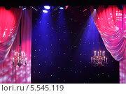 Купить «Шторы с розовым освещением, софиты и люстры в театре», фото № 5545119, снято 23 апреля 2012 г. (c) Losevsky Pavel / Фотобанк Лори