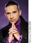 Купить «Фокусник в сценическом костюме», фото № 5550099, снято 16 мая 2013 г. (c) Andrejs Pidjass / Фотобанк Лори