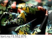Купить «Складки чёрной ткани с цветными рисунками», фото № 5552875, снято 14 августа 2013 г. (c) Morgenstjerne / Фотобанк Лори